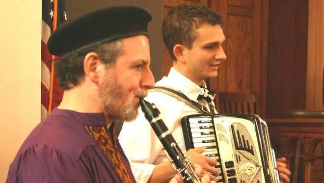 Klezmer musicians Allen Lutins and David Zakalik perform at last year's Chanukah Festival at Temple Beth El in Ithaca.