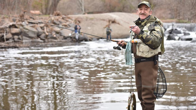 Michael Goldberg of Fair Lawn shows his limit catch of 6 trout caught at Dunkerhook Area of Saddle River in Paramus, on opening day for trout fishing season in 2016.