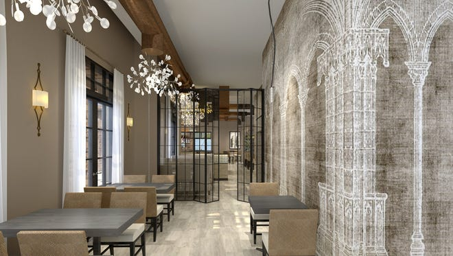 St. Amand Kitchen and Cocktails will have a large bar, private dining space for parties and extended patio with more shaded areas. This rendering shows a seating area and some of the wall decor that resembles a modern cathedral.