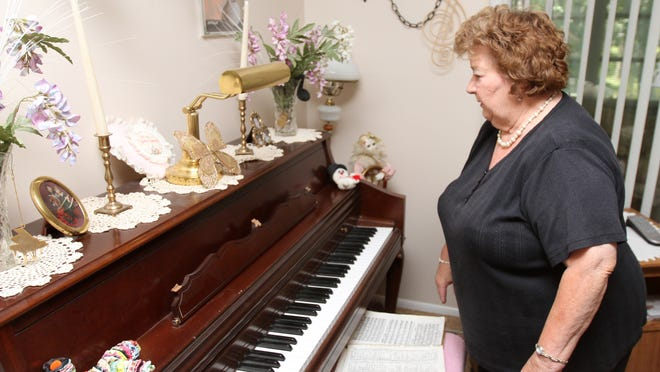 Doris Chapin looks at piano damaged during a move from Virginia to her current home in Brick.