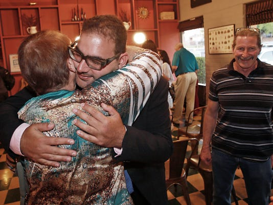Newly elected city Rep. Peter Svarzbein receives a hug from mother Sylvia Svarzbein on Saturday at a reception at  Eloise Restaurant.