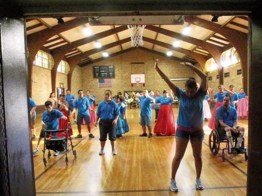 Director Cristy Acuña, foreground, shows the Estrellitas de Dios folklorico group a routine during a rehearsal at St. Pius X Catholic Church on Monday. The group will travel to Los Angeles to perform at the Special Olympics World Games set for July 26-27.