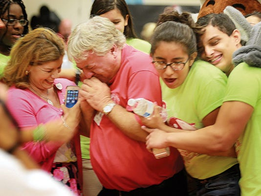 Jefferson High School teacher John Gable is overcome with emotion after being introduced at a school assembly Monday as a finalist for Texas Teacher of the Year. Gable, who has been with the school for 23 years, earned the Region 19 Secondary Teacher of the Year title Saturday.