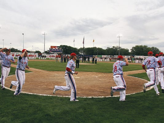 Members of D-Bat Leach run onto the field during the opening ceremonies of the 2015 Connie Mack World Series at Ricketts Park in Farmington.