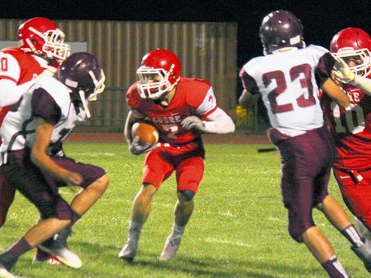 Danny Udero/Sun-News   Cobre wide receiver Dominic Redwine tries to find some run after receiving a pass during the third quarter against Tularosa on Friday night.