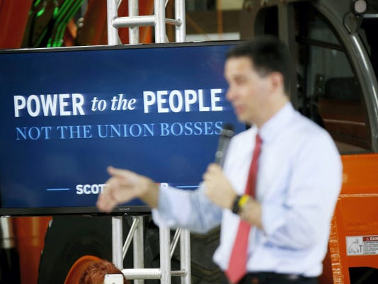 Republican presidential candidate Wisconsin Gov. Scott Walker speaks during a town hall meeting Monday, Sept. 14, 2015, in Las Vegas. (AP Photo/Isaac Brekken)