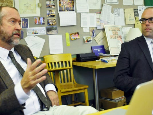 Tom Thorn, left, and Greg Lynch, both Latin teachers at Mercersburg Academy, talk Friday about a project in which students selected different celebrities to portray gods, in the first ever Pantheon project at the school.