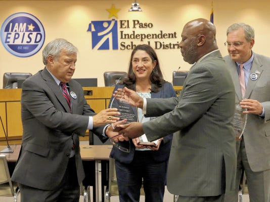 Outgoing Board of Managers members Ed Archuleta, from left, Carmen Arrieta-Candelaria and Dee Margo get a plaque from Texas Education Commissioner Michael L. Williams for their service shortly after being relieved of their duties serving the El Paso Independent School District for the past two years.