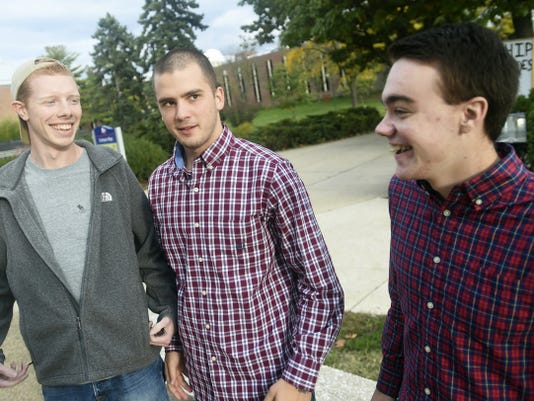 Joe DeSalis, left, Evan Shircliffe and Brandon Ferrance, Republicans at Shippensburg University, talk earlier this month about some of the few openly Republican students at their school.