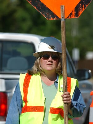 A file photo of a construction worker at a work site on a road.