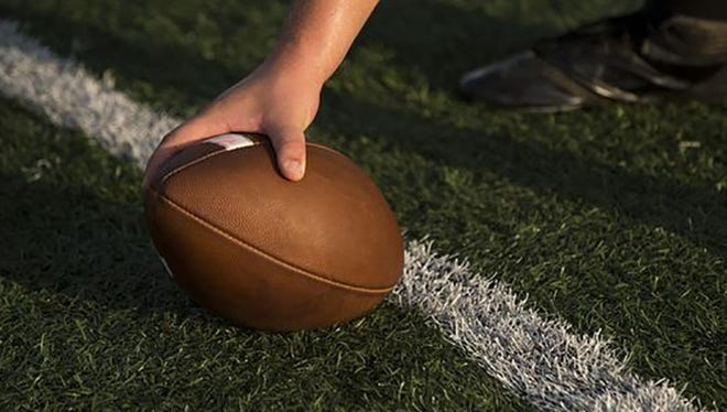 2 high school football players are under investigation.