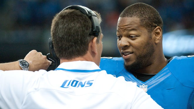 Sep 8, 2013; Detroit, MI, USA; Detroit Lions defensive tackle Ndamukong Suh (90) listens to head coach Jim Schwartz during the second quarter against the Minnesota Vikings at Ford Field. Mandatory Credit: Tim Fuller-USA TODAY Sports ORG XMIT: USATSI-132574 ORIG FILE ID:  20130801_ads_af2_014.JPG