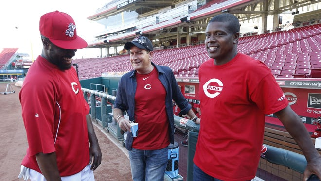 Actor Charlie Sheen and guest analyst on ESPN's Baseball Tonight along with his best friend Tony Todd took time during batting practice to meet Reds Brandon Phillips at Great American Ball Park prior to their game against the St. Louis Cardinals.