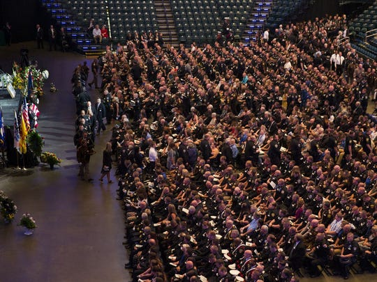 Mourners fill Bankers Life Fieldhouse in Downtown Indianapolis for the funeral of slain Southport Police Lt. Aaron Allan on Aug. 5, 2017.