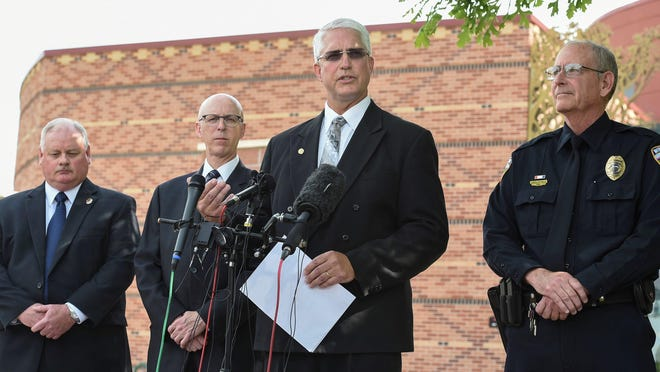 Law enforcement officials speak Thursday in Loveland about the shooting death of William Connole there Wednesday night.