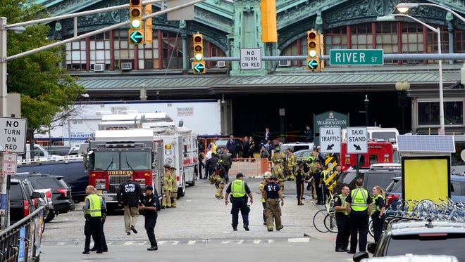 Emergency personnel respond to a train crash inside the Hoboken train station, in Hoboken, N.J. on September 29, 2016