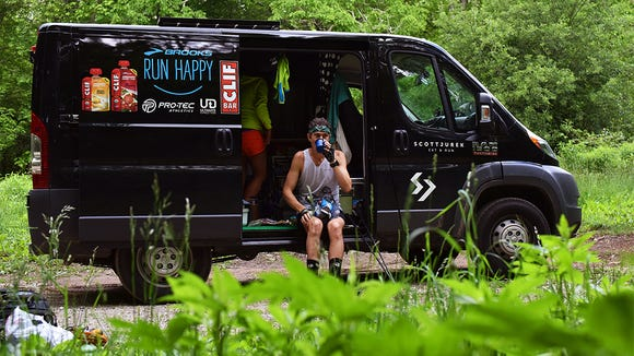 Scott Jurek, attempting an Appalachian Trail thru-hike supported speed record, stops for a quick refueling.