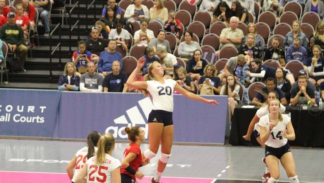 CNT Red's Taryn Kloth (20) goes up for a hit against CNT Blue on Tuesday, June 27, 2017. Kloth and CNT Red defeated CNT Blue in three sets to open the competition phase with the U.S. Collegiate National Team-Minneapolis.
