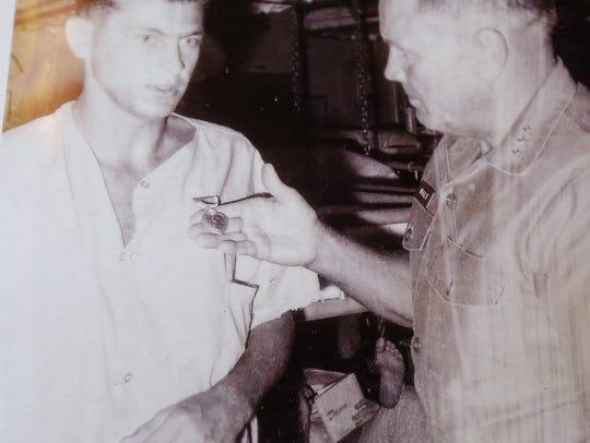 A 1967 photo of Vietnam War veteran Tom Scherg receiving