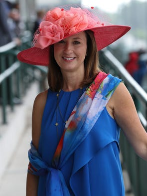 Robin Owens wore an accessory to match her hat on Derby