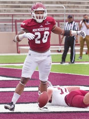 Aggies running back Osirius Burke celebrates after scoring a touchdown during the spring game at Aggie Memorial Stadium Saturday afternoon.
