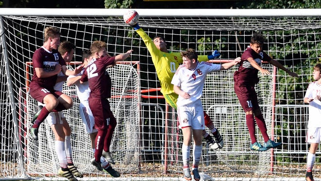 Bergen Catholic goalkeeper Nick Vafiadis #0 makes a diving save in the first half. Bergen Catholic and Don Bosco boys soccer tied 1-1 in Oradell, NJ on Monday, September 25, 2017.