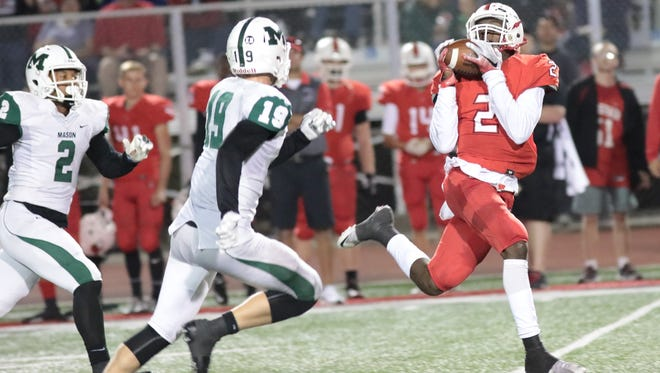 Coleiran's  Ja'von Hicks catches a touchdown pass at the end of the first half of the Cardinals football game against Mason last September.