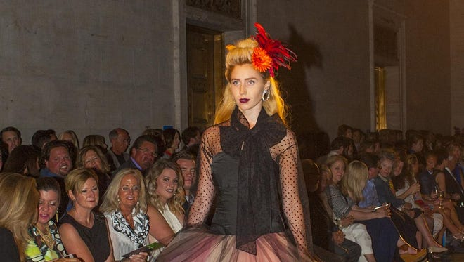 Model Caroline Reason wears an Oscar de la Renta dress at Fash Bash on Thursday.