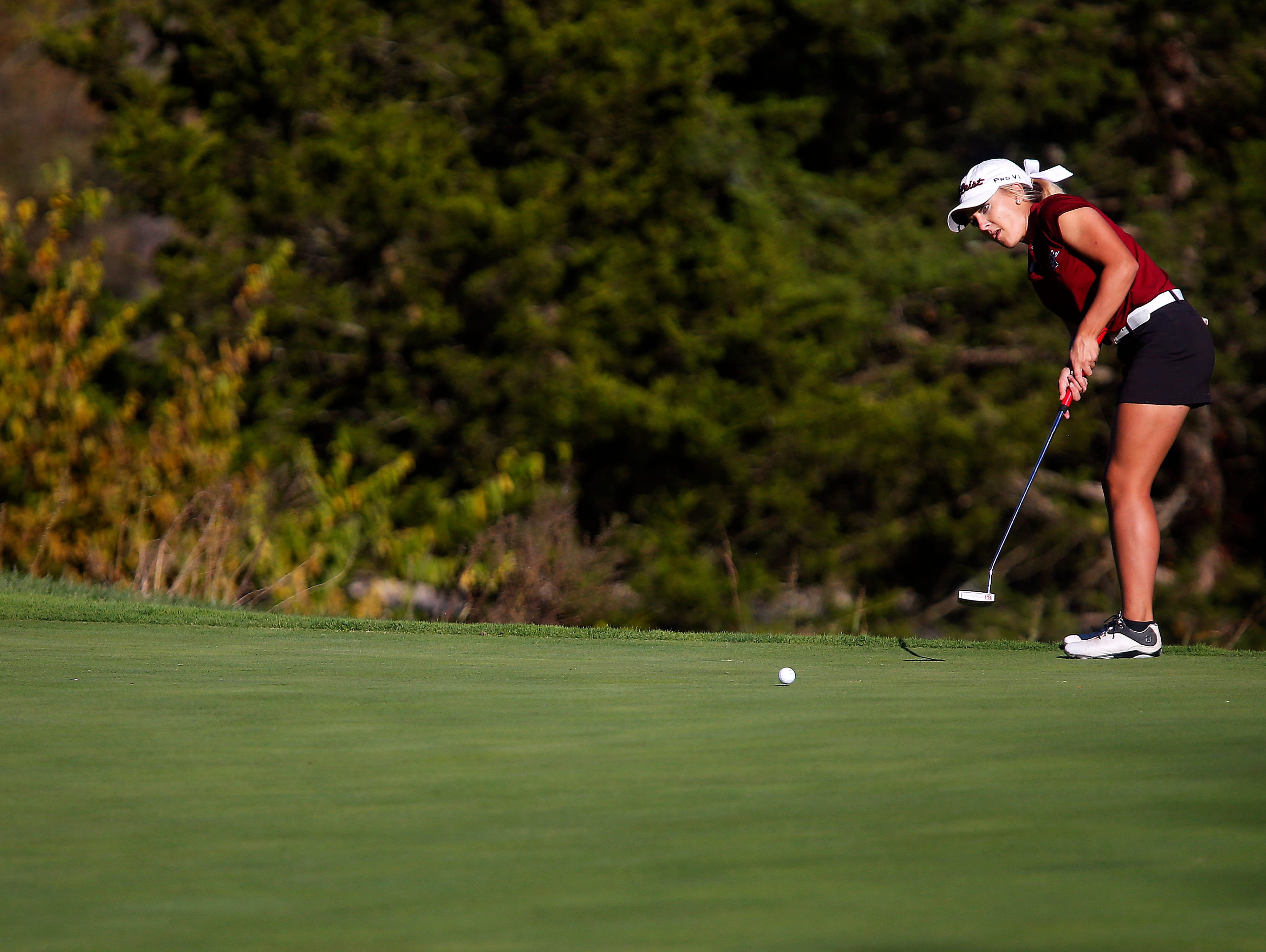 Warrensburg High School golfer Taylor BeDell putts on the 18th green during the 2015 MSHSAA Class 2 Girls Golf State Championship played at Rivercut Golf Club in Springfield, Mo. on Oct. 13, 2015. BeDell barely avoided a playoff with Kickapoo's Ari Acuff after Acuff missed an eagle putt on the 18th to give BeDell the state title.