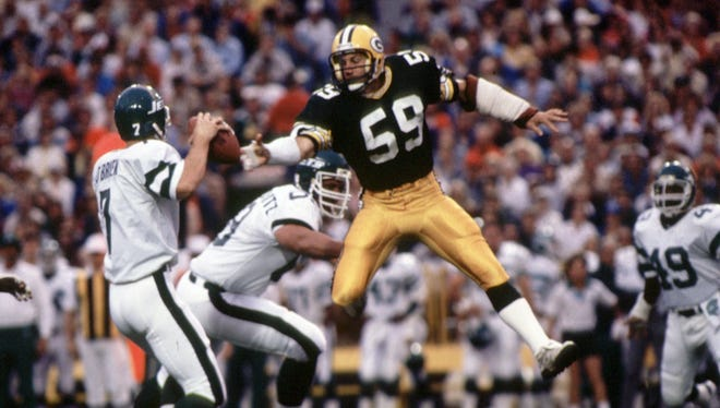Packers linebacker John Anderson pressures Jets quarterback Ken O'Brien in a 1985 game.