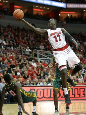 Louisville's Deng Adel rolls in two points during second half action against George Mason. Nov. 12, 2017.