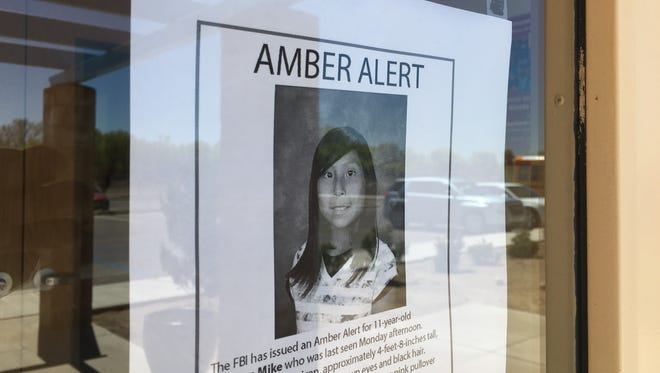 A poster of Ashlynne Mike is posted Tuesday at the San Juan Chapter house in Lower Fruitland. The poster was taken down shortly after police confirmed the 11-year-old's body had been found near the Shiprock pinnacle.