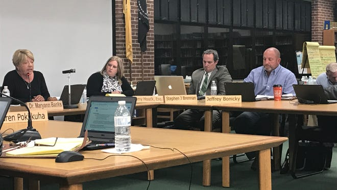 Pinelands Regionals officials, from left to right, Board of Education President Susan M. Ernst, attorney Amy Houck, Business Administrator Stephen Brennan, and board member Jeffrey Bonicky, are shown Nov. 6, 2017.