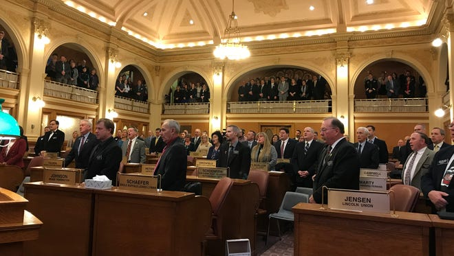 """South Dakota lawmakers stood to sing """"Amazing Grace"""" during a tribute ceremony for former Rep. Craig Tieszen. Tieszen died last month in a kayaking accident."""