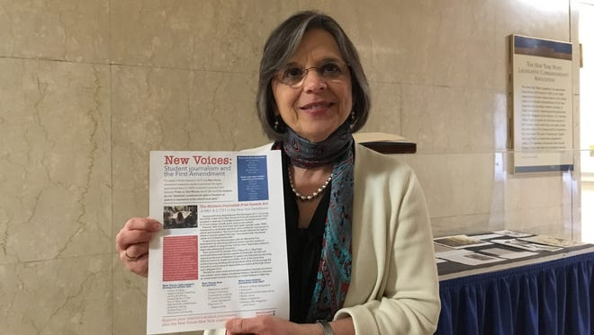 Assemblywoman Donna Lupardo, D-Endwell, Broome County, shows a pamphlet in support of a bill to give students more rights when they write for the school newspaper at the state Capitol on Tuesday, April 24, 2018.
