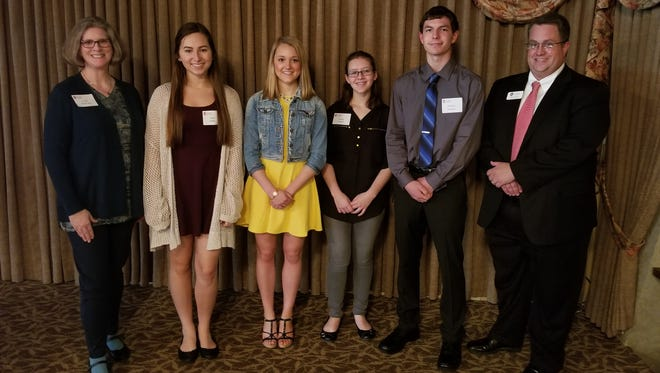 Pictured are the 2018 Wisconsin Alumni Association Fond du Lac Chapter scholarship winners. From left are Leigh Kohlmann, WAA Scholarship Committee chair, Anna Miller, Alexa Guelig, Hailey Vadnais, Michael Schaefer and Steve Leaman, WAA Chapter president. Not pictured: Kayla Duel.