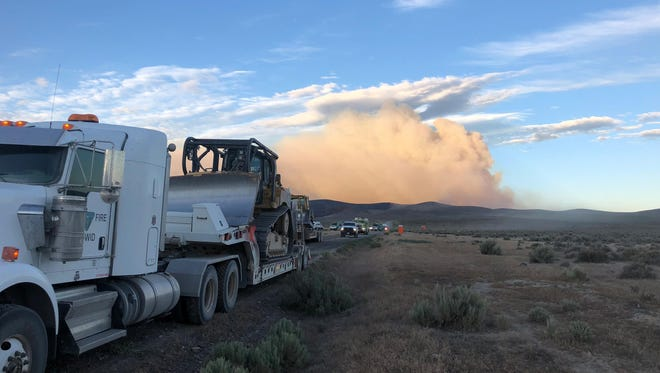 A Bureau of Land Management truck carrying a bulldozer near the Martin Fire.