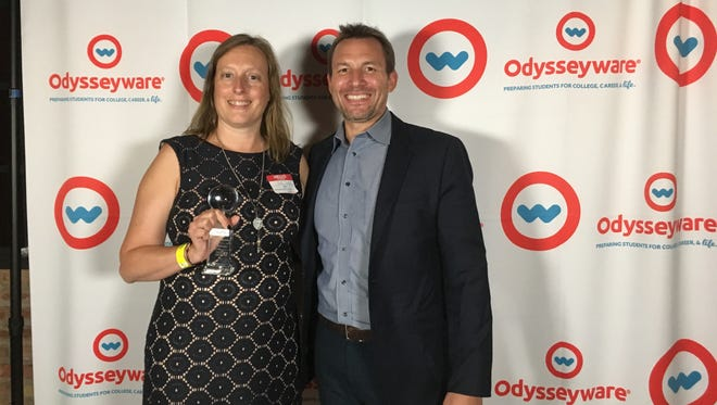 Holly Griffin and Matthew Given, CEO of Odysseyware, at the awards ceremony in Chicago.
