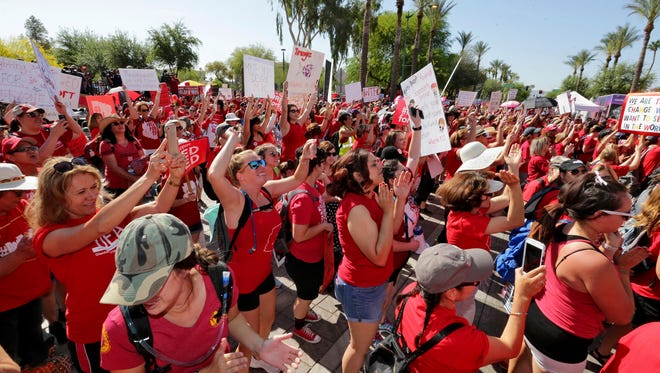 Teachers rally outside the Capitol on April 27 in Phoenix during school walkouts over low salaries.