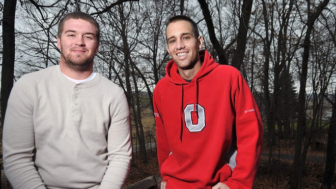 Eric Stitzlien, right, and his bother-in law Adam Reidenbach pose for a photo.
