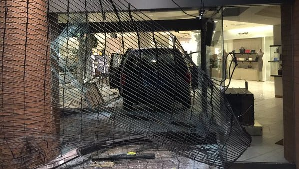 A look at the minivan which crashed through the front of Saks Fifth Avenue in Downtown.