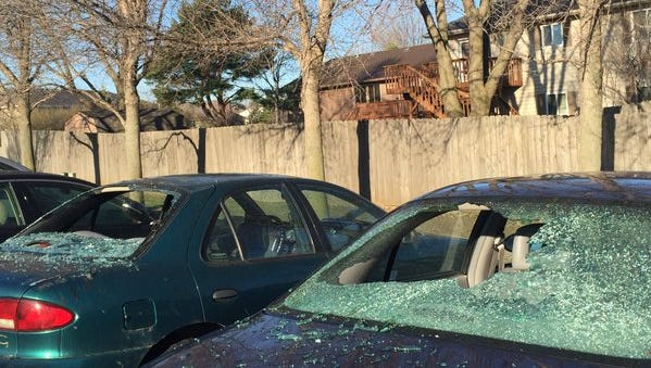 Two of the cars whose windows were shattered in the 5400 block of West 57th Street early Thursday morning.