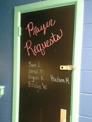 """The """"prayer request"""" board in an Oak Grove classroom has been painted over."""