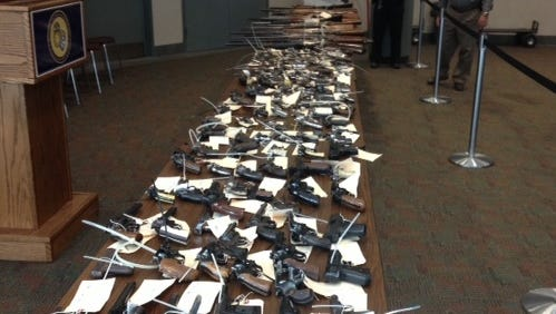 Rochester police display the guns collected at one of their buyback events.