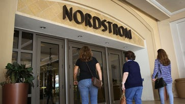 Shoppers enter a Nordstrom store on April 19, 2016 in Miami, Florida.  Nordstrom is partnering with J. Crew to sell certain merchandise from J. Crew's collection in its department stores.