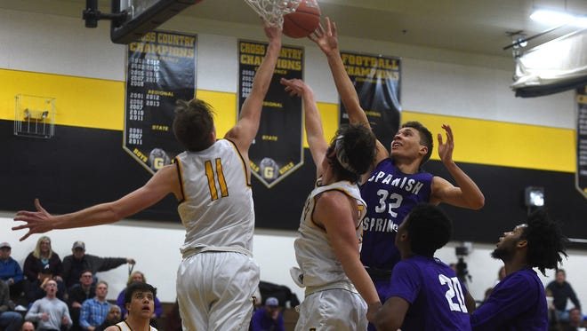 Spanish Springs' Jalen Townsell (32) tries to shoot over Galena's Moses Wood (11) during their basketball game in Reno on Dec. 15, 2017.