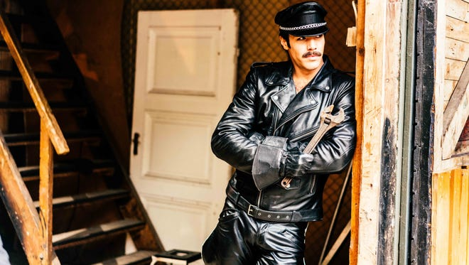 """A sexy apparition of sorts appears as a source of inspiration to artist Touko Laaksonen in the film """"Tom of Finland."""""""