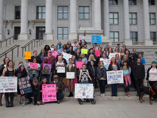 Dozens of Utah women march to the Capitol during the