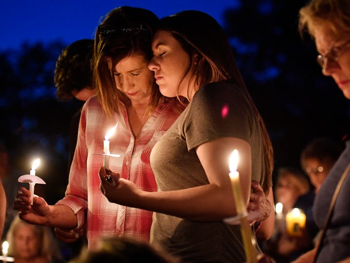 Connie Robinson, left, hugs her daughter Kayla Compton,