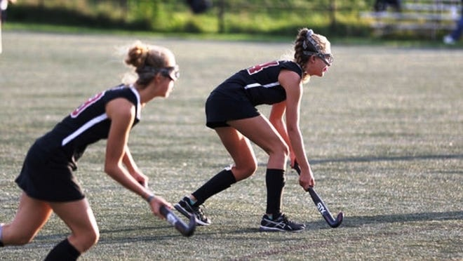 Marblehead field hockey player Jessica West, a senior left wing, left, and teammate Cannan Whittier, left midfielder, are shown playing defense during a game last year. But this year, they might have to wait until late February to play after the Northeastern Conference principals voted last week to delay the season, while opting instead to schedule games in the newly created Fall 2 season, because five of the conference schools were in Red Zone communities. However, since then, Saugus and Salem have been upgraded, and as a result the conference's superintendents could reverse the original decision in time for the Sept. 18 start date.
